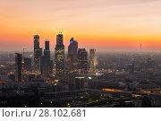 Купить «MOSCOW - JUN 26, 2015: Moscow International Business Center skyscrapers, highway, railway during sunset in Moscow, Russia», фото № 28102681, снято 26 июня 2015 г. (c) Losevsky Pavel / Фотобанк Лори