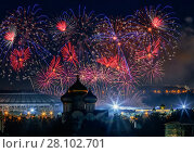 Firework above Luzhniki stadium and church at night in Moscow, Russia (2015 год). Стоковое фото, фотограф Losevsky Pavel / Фотобанк Лори