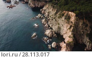 Купить «Aerial view of rocky coastline of Mediterranean Sea near Tossa de Mar, Spain», видеоролик № 28113017, снято 12 февраля 2018 г. (c) Яков Филимонов / Фотобанк Лори
