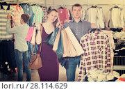 Купить «Couple carrying paper bags with purchase», фото № 28114629, снято 13 апреля 2017 г. (c) Яков Филимонов / Фотобанк Лори