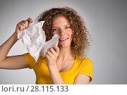 Купить «woman furiously tore the paper», фото № 28115133, снято 29 января 2018 г. (c) Типляшина Евгения / Фотобанк Лори