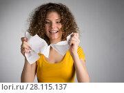 Купить «woman furiously tore the paper», фото № 28115137, снято 29 января 2018 г. (c) Типляшина Евгения / Фотобанк Лори