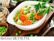 Купить «Chicken soup with green peas», фото № 28115713, снято 21 декабря 2017 г. (c) Надежда Мишкова / Фотобанк Лори