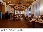 Купить «VASILYEVSKOYE, MOSCOW REGION, RUSSIA - FEB 3, 2017: Interior of restaurant Miraval at Provence-Hotel Four Seasons in evening. The interior of the restaurant is made in natural style.», фото № 28115989, снято 3 февраля 2017 г. (c) Losevsky Pavel / Фотобанк Лори