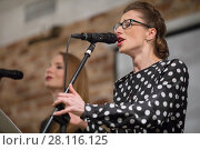 Купить «Woman in glasses sings into microphone and other woman out of focus on stage», фото № 28116125, снято 18 февраля 2017 г. (c) Losevsky Pavel / Фотобанк Лори