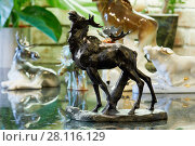 Купить «Porcelain figurine of MOSCOW, RUSSIA - OCT 28, 2016: Metal figurine of roaring elk at private collection.standing elk bells.», фото № 28116129, снято 28 октября 2016 г. (c) Losevsky Pavel / Фотобанк Лори