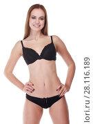 Купить «Pretty smiling girl in underwear poses isolated on white background», фото № 28116189, снято 31 октября 2016 г. (c) Losevsky Pavel / Фотобанк Лори