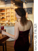 Купить «Woman in red slinky evening dress with glass of beverage at bar counter, rear view», фото № 28116321, снято 1 ноября 2016 г. (c) Losevsky Pavel / Фотобанк Лори