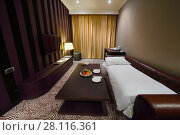 Купить «YEREVAN, ARMENIA - JAN 4, 2017: Accommodation in Hotel National, Created in a business style, the comfortable hotel allows every guest to feel welcome», фото № 28116361, снято 4 января 2017 г. (c) Losevsky Pavel / Фотобанк Лори