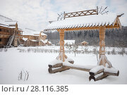 Купить «Wooden old-style bench, log buildings in Russian Orthodox Monastery at winter day», фото № 28116385, снято 15 ноября 2016 г. (c) Losevsky Pavel / Фотобанк Лори