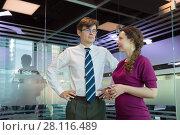 Купить «Beautiful woman and man in shirt and tie stand in modern office», фото № 28116489, снято 20 ноября 2016 г. (c) Losevsky Pavel / Фотобанк Лори