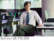 Купить «Handsome man in shirt and tie sits at table with laptop in modern office», фото № 28116509, снято 20 ноября 2016 г. (c) Losevsky Pavel / Фотобанк Лори