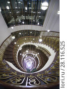 Купить «YEREVAN, ARMENIA - JAN 7, 2017: Spiral staircase with illumination in Hotel National, it is modern hotel, member of Luxury Group», фото № 28116525, снято 7 января 2017 г. (c) Losevsky Pavel / Фотобанк Лори