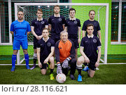 Купить «MOSCOW, RUSSIA - JAN 23, 2017: Team of futsal players poses at goalpost», фото № 28116621, снято 23 января 2017 г. (c) Losevsky Pavel / Фотобанк Лори