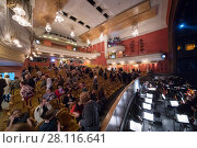 Купить «MOSCOW - JAN 25, 2017: People and orchestra pit during intermission of performance in New Opera theater», фото № 28116641, снято 25 января 2017 г. (c) Losevsky Pavel / Фотобанк Лори