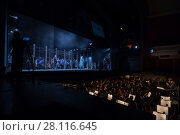 Купить «MOSCOW - JAN 25, 2017: Prisoners, turnkeys on stage and orchestra pit at Passenger performance in Moscow Theater New Opera», фото № 28116645, снято 25 января 2017 г. (c) Losevsky Pavel / Фотобанк Лори