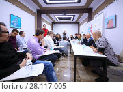 MOSCOW - OCT 20, 2016: Meeting with NEVA band in Empire tower in Moscow city business center, Empire Business Complex - 60-story skyscraper built in 2006. Редакционное фото, фотограф Losevsky Pavel / Фотобанк Лори
