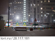 Купить «Residential building and children playground during evening snowfall», фото № 28117181, снято 22 февраля 2016 г. (c) Losevsky Pavel / Фотобанк Лори