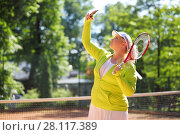 Купить «Young woman makes selfie with racket on tennis playground outdoor», фото № 28117389, снято 24 июня 2016 г. (c) Losevsky Pavel / Фотобанк Лори