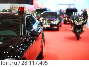 Купить «Black car of cortege with blinker on red carpet and bike at exhibition», фото № 28117405, снято 7 марта 2016 г. (c) Losevsky Pavel / Фотобанк Лори