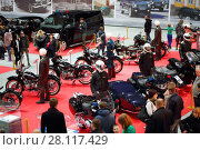 MOSCOW - MAR 07, 2016: Retro bikes and cars on exhibition Oldtimer-Gallery in Sokolniki Exhibition Center. It is only one in Russia exhibition of vintage cars and technical antiques. Редакционное фото, фотограф Losevsky Pavel / Фотобанк Лори