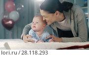 Купить «Happy woman with a baby», видеоролик № 28118293, снято 20 февраля 2018 г. (c) Илья Шаматура / Фотобанк Лори