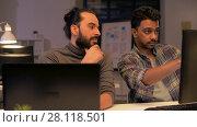 Купить «creative team with computer working late at office», видеоролик № 28118501, снято 29 января 2018 г. (c) Syda Productions / Фотобанк Лори