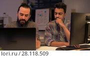 Купить «creative team with computer working late at office», видеоролик № 28118509, снято 29 января 2018 г. (c) Syda Productions / Фотобанк Лори