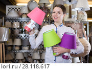 Купить «Pretty woman is looking on modern lamps», фото № 28118617, снято 20 декабря 2017 г. (c) Яков Филимонов / Фотобанк Лори