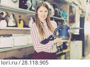 Купить «Happy saleswoman offering steam cleaner», фото № 28118905, снято 12 декабря 2017 г. (c) Яков Филимонов / Фотобанк Лори
