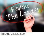 Купить «Man Hand writing Follow The Leader with black marker on visual screen», фото № 28120609, снято 7 апреля 2020 г. (c) easy Fotostock / Фотобанк Лори