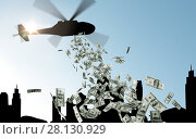 Купить «helicopter in sky dropping money over city», фото № 28130929, снято 14 апреля 2019 г. (c) Syda Productions / Фотобанк Лори