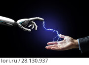 robot and human hand connected by lightning. Стоковое фото, фотограф Syda Productions / Фотобанк Лори