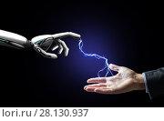 Купить «robot and human hand connected by lightning», фото № 28130937, снято 6 сентября 2016 г. (c) Syda Productions / Фотобанк Лори