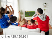 Купить «friends or soccer fans watching game on tv at home», фото № 28130961, снято 14 августа 2016 г. (c) Syda Productions / Фотобанк Лори