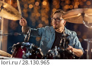 Купить «male musician playing drums and cymbals at concert», фото № 28130965, снято 18 августа 2016 г. (c) Syda Productions / Фотобанк Лори