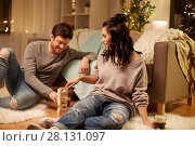 Купить «happy couple playing block-stacking game at home», фото № 28131097, снято 13 января 2018 г. (c) Syda Productions / Фотобанк Лори