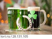 Купить «shamrock on glass of beer and horseshoe on table», фото № 28131105, снято 31 января 2018 г. (c) Syda Productions / Фотобанк Лори