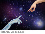 Купить «human and robot hands over space background», фото № 28131133, снято 9 апреля 2014 г. (c) Syda Productions / Фотобанк Лори