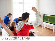 Купить «football fans watching soccer game on tv at home», фото № 28131149, снято 14 августа 2016 г. (c) Syda Productions / Фотобанк Лори