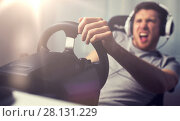 Купить «close up of man playing car racing video game», фото № 28131229, снято 12 марта 2016 г. (c) Syda Productions / Фотобанк Лори