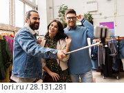 Купить «friends taking selfie at vintage clothing store», фото № 28131281, снято 30 ноября 2017 г. (c) Syda Productions / Фотобанк Лори