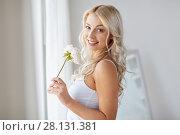 Купить «woman in underwear smelling flower at window», фото № 28131381, снято 20 апреля 2017 г. (c) Syda Productions / Фотобанк Лори