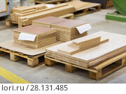 Купить «wooden boards and chipboards storing at factory», фото № 28131485, снято 10 ноября 2017 г. (c) Syda Productions / Фотобанк Лори
