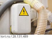 Купить «electric panel with caution sign», фото № 28131489, снято 10 ноября 2017 г. (c) Syda Productions / Фотобанк Лори