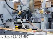 Купить «veneer or edge banding machine at factory», фото № 28131497, снято 10 ноября 2017 г. (c) Syda Productions / Фотобанк Лори