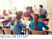 Купить «group of students writing school test», фото № 28131537, снято 22 апреля 2016 г. (c) Syda Productions / Фотобанк Лори