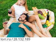 Купить «Adult male is resting on the lap of woman», фото № 28132189, снято 10 августа 2017 г. (c) Яков Филимонов / Фотобанк Лори