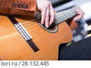 Купить «man in jacket playing an acoustic guitar», фото № 28132445, снято 29 марта 2017 г. (c) Яков Филимонов / Фотобанк Лори