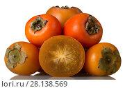 Купить «Ripe persimmon fruits and cut piece close up isolated on white», фото № 28138569, снято 20 декабря 2017 г. (c) Сергей Молодиков / Фотобанк Лори
